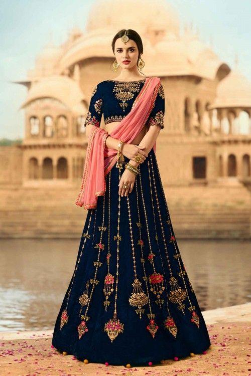 Bridal navy blue velvet lehenga with velvet choli now in shop. Andaaz Fashion brings latest designer ethnic wear collection in MY