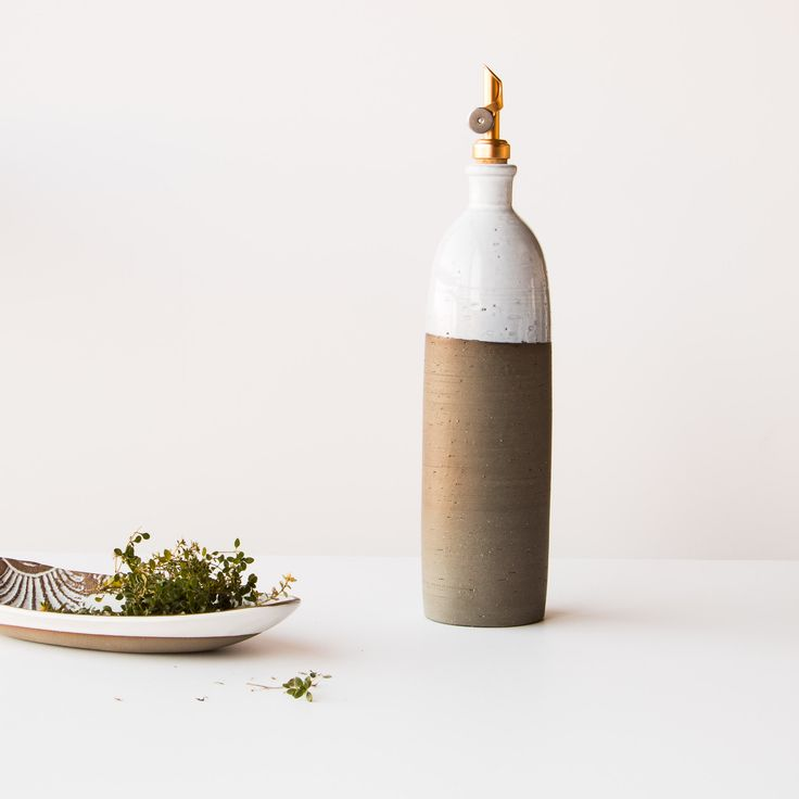This beautiful ceramic oil dispenser is a blend of traditional and contemporary styles, To be used without moderation. Handmade in the Eastern Townships, Quebec, Canada