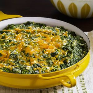 Creamed Spinach Casserole - Cottage cheese and beaten egg whites are folded in for a fluffy, creamy, and healthy alternative to the traditional calorie-laden creamed spinach.
