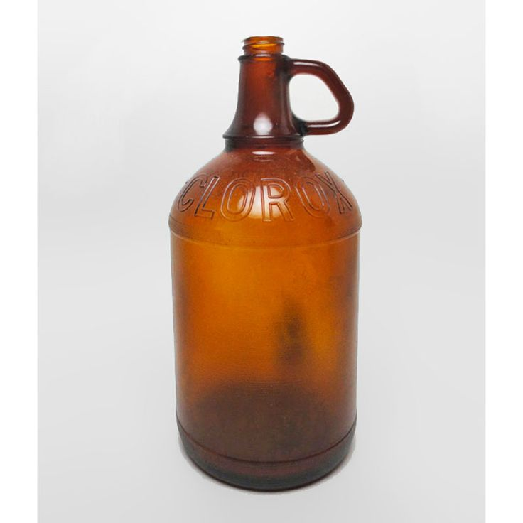 Half Gallon Owens Illinois Brown Clorox Bleach Bottle Jug - VBCJC120 - Half gallon brown Clorox Bleach bottle jug with thumb handle and Clorox diamond logo. Owens Illinois. As found condition with no cracks or chips