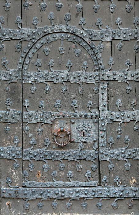 aged door with metal work