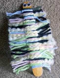 Bookmark... tongue depressor and tied yarn... cute !