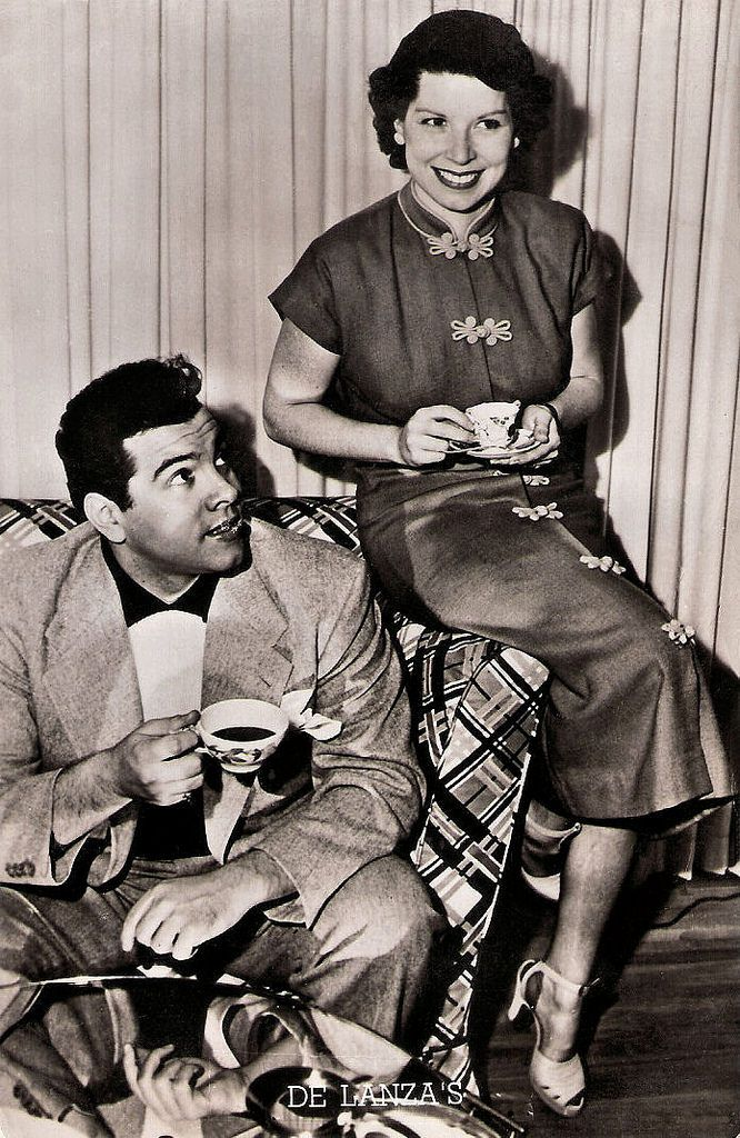 "https://flic.kr/p/QTkmnG | Tea Time with the Lanzas | Dutch postcard. Photo: MGM.  Mario Lanza and his wife Betty Hicks Lanza.  Mario Lanza (1921–1959) was an American tenor, actor and Hollywood film star of the late 1940s and the 1950s. His masterpiece was The Great Caruso (Richard Thorpe, 1951), the top-grossing film in the world in 1951. Lanza's voice was so dazzling that an awestruck Arturo Toscanini called it the ""voice of the century"".   See for more vintage postcards of Holl..."