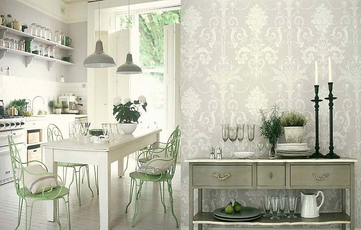 Antique white kitchen with lovely chairs and wallpaper