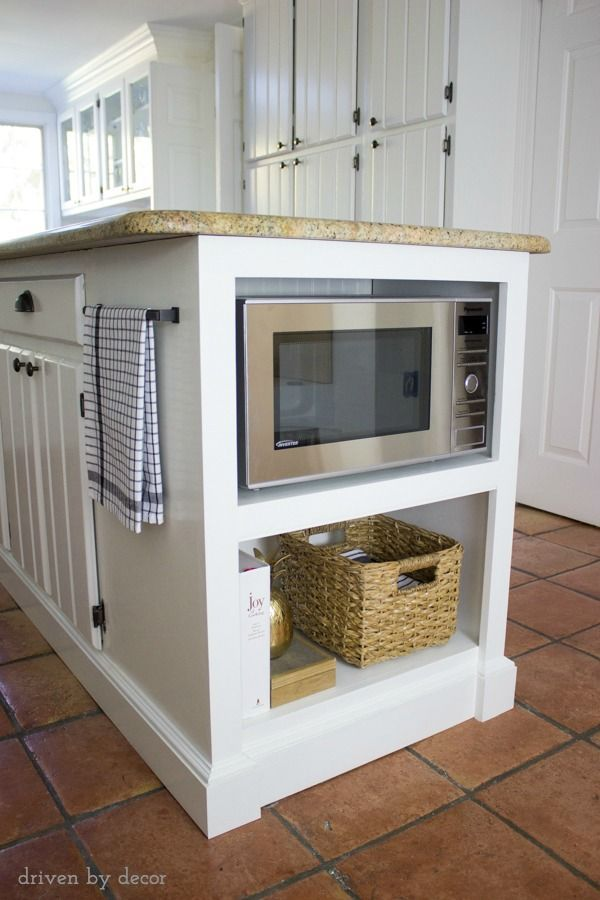 Our microwave is off of the counter and on a built-in shelf on the end of our kitchen island! The perfect solution for kitchens with limited counterspace!