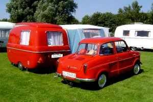 Tiny red caravan and a red retro car