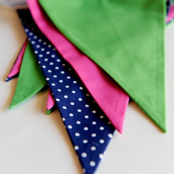 Slumber Party Pennant Banner; This sweet, handmade, fabric pennant banner serves as the picture-perfect backdrop for the Slumber Party. Measures 9.5 feet long with 9 pennants total.