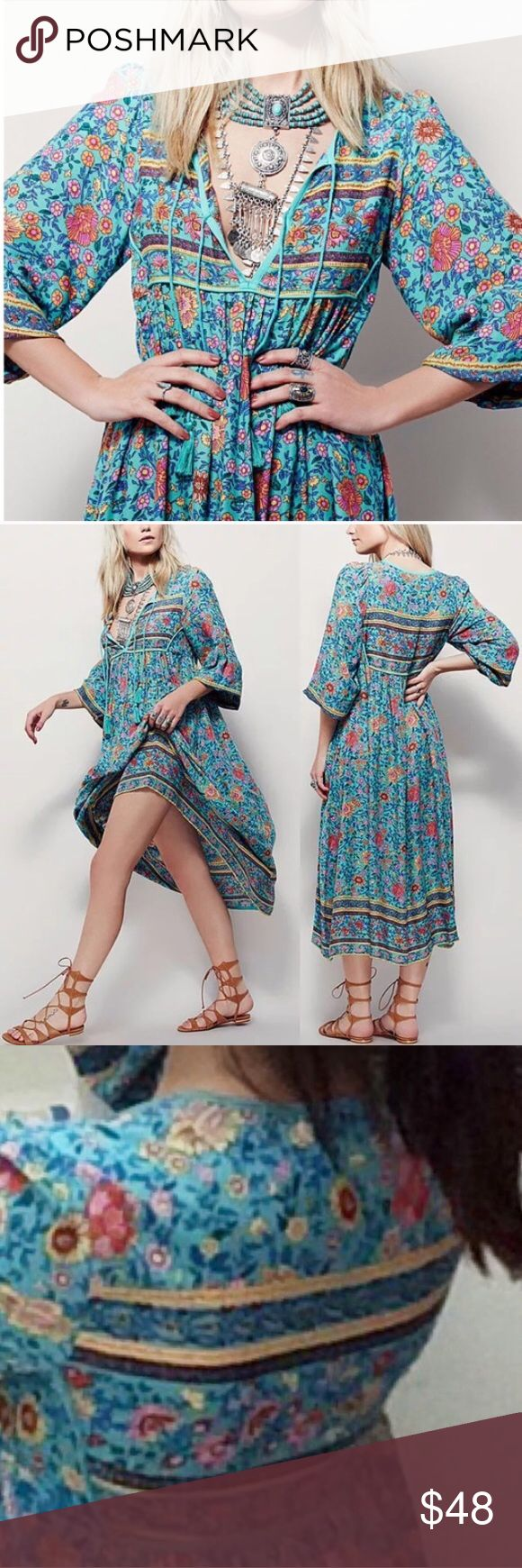 """Folk Town Boho Turquoise Maxi DRESS Floral NEW BRAND NEW!! Boho maxi-dress featuring a V-neckline w/ adjustable ties and tassel ends. Wide sleeves w/ elastic cuffs. In a beautifully detailed print & silhouette, this vintage-inspired floral pattern is in an oversized fit. 🌟Similar style by Free People, Spell & the Gypsy Collective.🌟  S: Bust: 39""""/Waist: 35.9""""/L: 46.4"""" M: Bust: 39.8""""/Waist: 37""""/L: 47.2"""" L: Bust: 41""""/Waist: 38.6""""/L: 48"""" XL: Bust: 41.9""""/Waist: 39""""/L: 48.8""""  🌟Item is Brand…"""