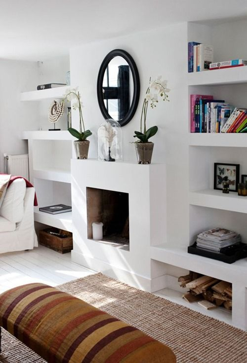 masonry fireplace with fitted shelves