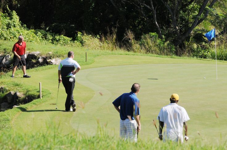 Golfers on the greens of the White Witch Golf Course during the 2013 Jamaica Pro Am