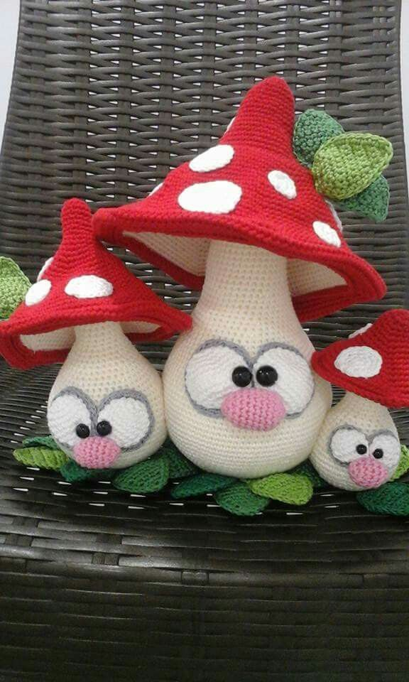 Mushrooms or toadstools with funny faces. Three different sizes.