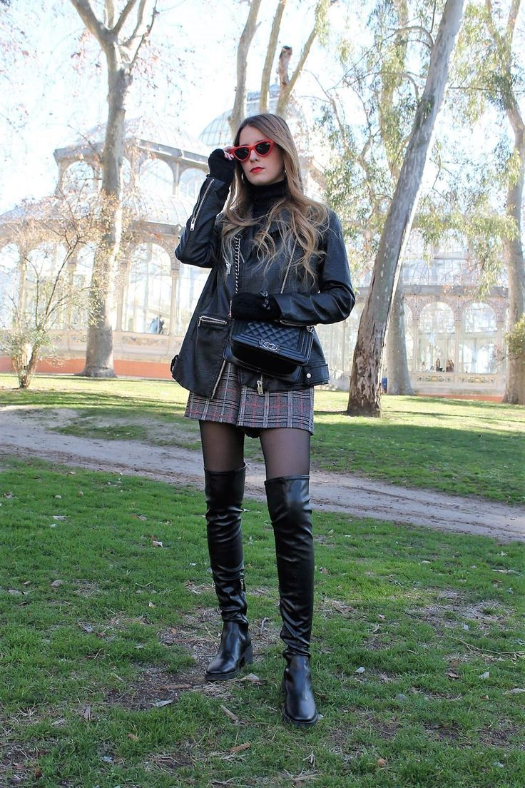 Black thigh high  boots combined with black pantyhose and a short skirt. #thighhighboots
