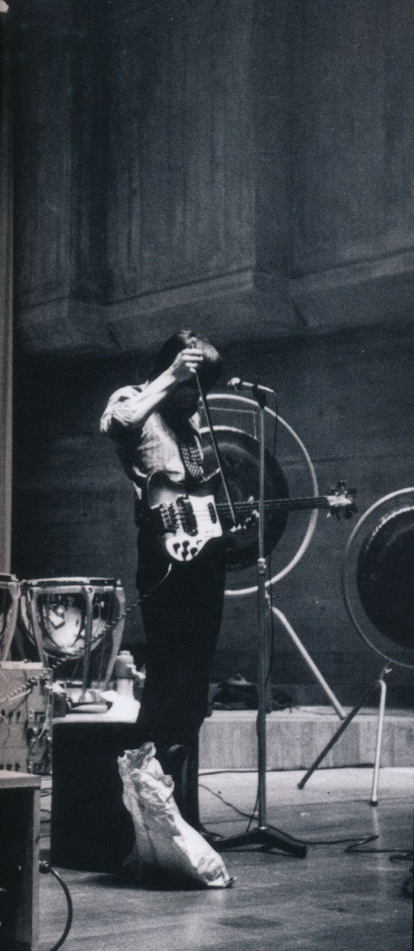 Roger Waters bowing his bass strings, 1960s