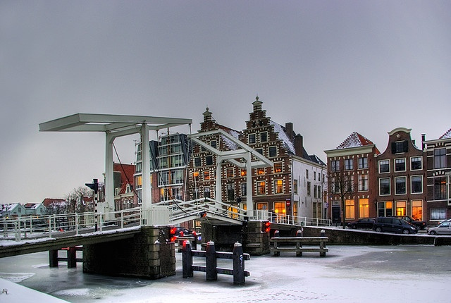 """Haarlem in a cold evening with in the background the 17 th. century old brewery """" The Elephant """""""