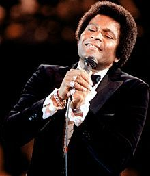 Charley Frank Pride (born March 18, 1938) is an American country music singer, musician/guitarist, recording artist, performer, and business owner. His greatest musical success came in the early-to-mid 1970s when he became the best-selling performer for RCA Records since Elvis Presley. In total, he has garnered 39 No. 1 hits on the Billboard Hot Country Songs charts. Pride and his wife live in Dallas. In 2010, Pride became a special investor and minority owner of the Texas Rangers.