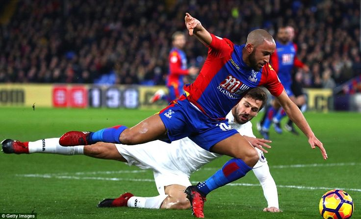 Swansea striker Llorente brings down Andros Townsend with a reckless challenge and was given a deserved yellow card