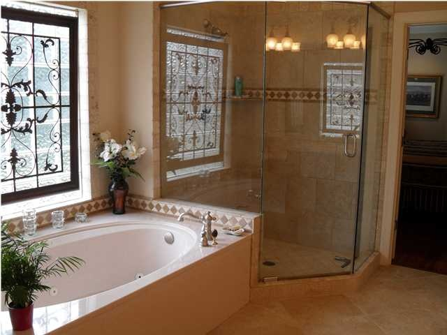 jetted tub, block glass window, large separate walk-in shower