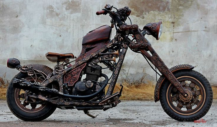 This is a motorcycle made out of mostly wood, much of it  hand carved.