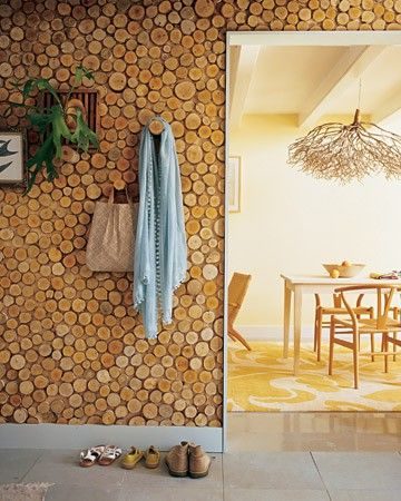 If I had a mountain house, I would love this wall and chandelier. Great reuse of natural materials.