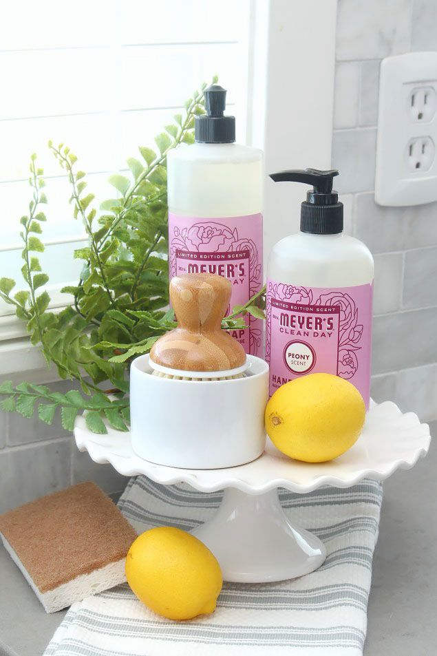 Use a cake stand for a pretty way to display dish soap.  Lots of great spring cleaning tips!