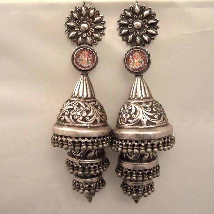 "Silver, India Description A pair of earrings unique antique from the Rajasthan called ""phuljhumka"" and worn by Gypsy Lambadi or benjara nomads: in this case, 3 floors, floral designs are truly amazing ... these earrings are dedicated to Ganesh as shown in the small thumbnails under glass in the upper loops ... therefore their weight and size make parts for discerning collectors ... Weight: 99.85 gr ET102, 70 gr"