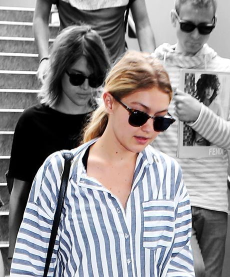 Gigi Hadid ASOS Boyfriend Shirt Airport Outfit | Gigi Hadid was spotted wearing said striped button-down while strolling off a flight at LAX. #refinery29 http://www.refinery29.com/gigi-hadid-boyfriend-shirt-outfit