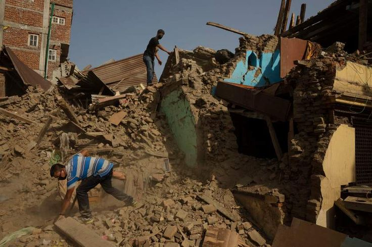 Residents look through wreckage in the town of Sankhu, which was largely destroyed in the earthquake, May 1, 2015.