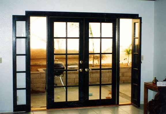 Replace the slider in the master bedroom with something for French windows with side panels