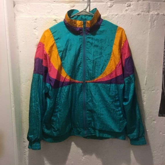 Vintage windbreaker It is blue, yellow, purple, and pink. It's super comfortable and on the right sleeve in the back, there are two small stains on the purple strip (see photo). Other than that, the windbreaker is fantastic. Sweaters