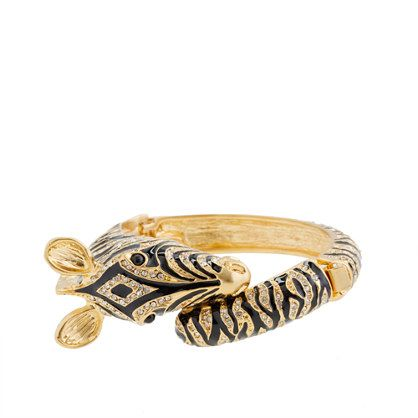 J crew Enameled zebra bangle. One of the quirky, quintessentially J.Crew animal collection pieces we can't get enough of, this superspecial zebra bangle is in near daily rotation. Cast in a chic oval shape and finished with a hinge so it sits closer to the wrist for a sleeker fit. A solo standout, but we love it layered too.