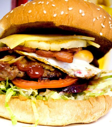 "Australian Hamburger ""The Lot""  is loaded with a runny fried egg, bacon, cheese, beets, pineapple, tomato, lettuce, onions and ketchup"