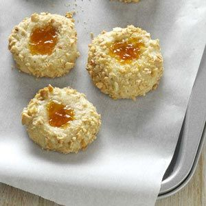 Apricot Thumbprints Recipe -Each dimpled delight holds a dab of apricot preserves—or whatever jam or jelly your family fancies most. —Jeanette Meidal, Savage, Minnesota