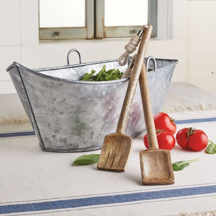 """Anchors away! Great for salads at the pool or cottage. Galvanized tin salad boat comes with wooden """"oar"""" serving utensils with knotted canvas rope accent"""