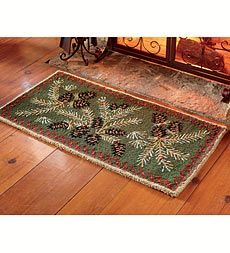 Adds cabin style and protection to your hearth with this hooked wool Pine Cone Hearth Rug. Wool is naturally fire-resistant and offers long-lasting, high-quality protection.