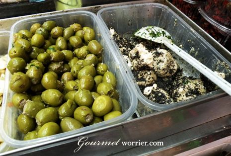 Maltese olives and Ġbejniet - local peppered goat cheese. Yum!