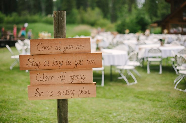 100 Mile House, BC // Outdoor Wedding // Photos by Tanis Katie Photography // www.taniskatie.com // Rustic Wedding // Wildflowers // Mason Jars // DIY Wedding // Rustic Wedding Decor // Chris and Sarah // Wood Center Pieces // Wood Pens // Wood Wedding Decor // Wedding Sign
