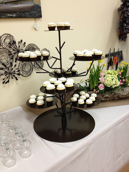 Brown rustic twig display stand Perfect for cupcakes, cakes and anything else you can think of! This stand will help create a beautiful rustic touch anywhere at your event!