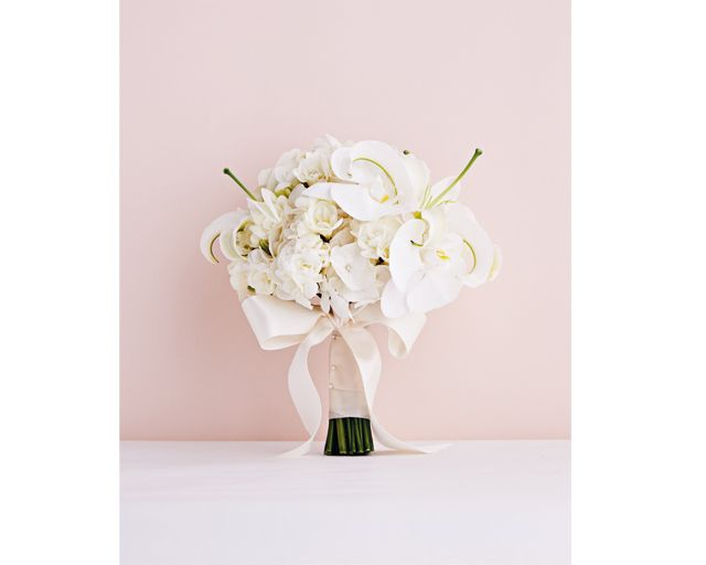 From simple and contemporary to rustic and whimsical, white bouquets are perfect for any wedding.  Casablanca lilies, hydrangeas, freesia and phalaenopsis orchids, $480, from FIORE DORATO. http://www.herworldplus.com/weddings/go-local-gorgeous-orchid-blooms-your-wedding-bouquet