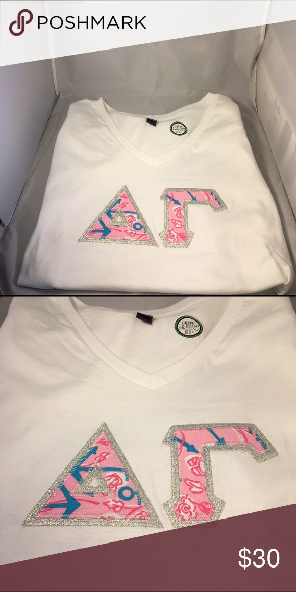 Delta Gamma Sorority Double Stitched -V-neck Small Ready to Ship-Delta Gamma Sorority Double Stitched Shirt-Fashion Print- White V-Neck-Small  Greek letters in sorority fashion print  Metallic silver background  Shirt color: White  Size Small  New!  Ships in one business day! Tops Tees - Short Sleeve