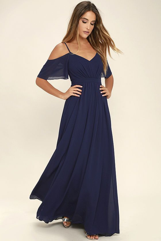 If you fancy a twirl in something spectacular, slip into the Ways of Desire Navy Blue Maxi Dress! Woven poly forms a lightly pleated triangle bodice supported by spaghetti straps and fluttering sleeves. A banded waist gives way to a cascading maxi skirt. Hidden back zipper/clasp.