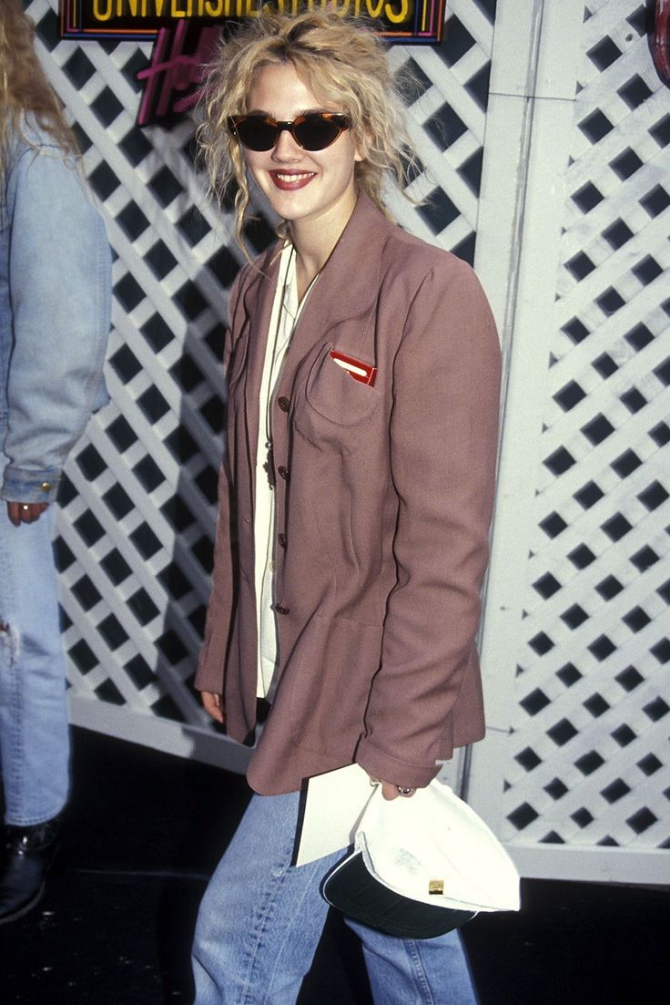 Can We Take A Moment To Admire Drew Barrymore's '90s Style? #refinery29  http://www.refinery29.com/drew-barrymore-lookbook-throwback-90s-fashion#slide-1  Thelma and Louise sunglasses, Levi's, and an old-school blazer. We will never, in our short, meaningless lives, look this cool. ...