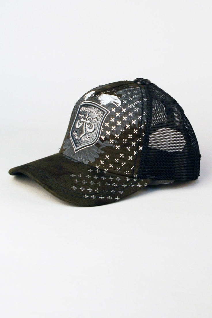 "Affliction® Hopeless Trucker Hat in Black for Men and Women.   It's hopeless think you can do better than this Affliction ""Hopeless"" trucker hat. The white on black Hopeless Trucker Hat is a can't-miss alternative to mens fitted caps. Proudly flying the fierce Affliction eagle framing the rubber fleur de lis Affliction logo patch. A cool background print in grey/white. Affliction mens hat looks great on ladies, too. Graphic custom hat by Affliction Clothing is a must-have addition to your…"