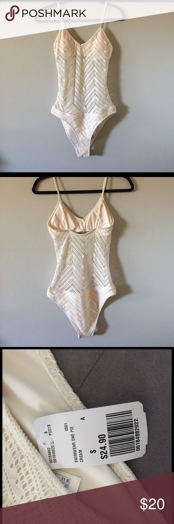 Cream One Piece Swimsuit Super cute one piece! Never worn, still has tags. Stomach is see through and top and bottom are lined. Light padding on top. Cream colored, size small. Forever 21 Swim One Pieces