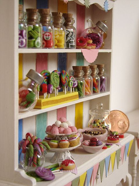 Miniature dollhouse candy display.
