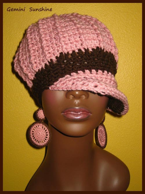 this sistah's crocheted hat & earrings sets are fire! she also makes handpainted earrings, sleeveless gloves and other accessories..check here out here: www.geminisunshine.etsy.com