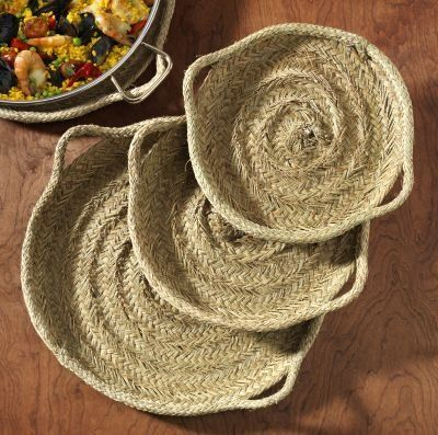 Esparto Grass Paella Pan Serving Tray (17 inches/44 cm) by La Familia Artesana. $55.00. For use with pans up to 17 inches. Beautiful decoration. 17in/44cm in diameter. Protects table from hot pan. Serve your paella creation on this beautiful esparto grass tray - it protects your table and brings a taste of rustic Spain to your celebration.  Esparto grass has been woven for centuries to make myriad household items. It is extremely durable, used for saddles, baskets an...