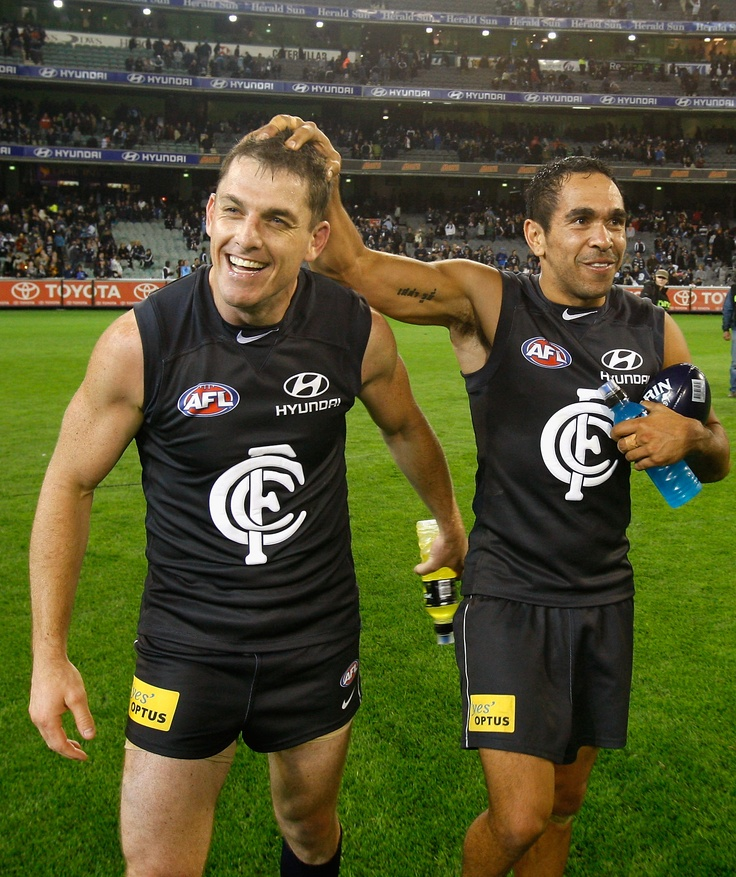 Heath Scotland and Eddie Betts celebrate their win in the Round 1 match against Richmond at the MCG in 2011.