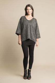 This long sleeve poncho is available in Small/ Medium (SM) & Medium Large (ML), SM pictured.   A Textured wool acrylic blend, the fabric is an acrylic base with wool flocked through on the exterior.   Charcoal is a great staple colour for your wardrobe.   The Namoi Poncho is great for layering with leggings and boots, jeans, long sleeve tops and skirts.   SMALL MEDIUM  BUST : 130cm WAIST: 120cm HIP: 110cm  MEDIUM LARGE BUST : 155cm WAIST: 140cm HIP: 130cm