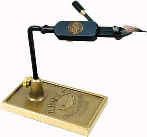 Regal Medallion Fly Tying Vise, Traditional base  https://fishingrodsreelsandgear.com/product/regal-medallion-fly-tying-vise-traditional-base/  Revolves around a 360° axis Articulates 220° up and down No need for adjustment