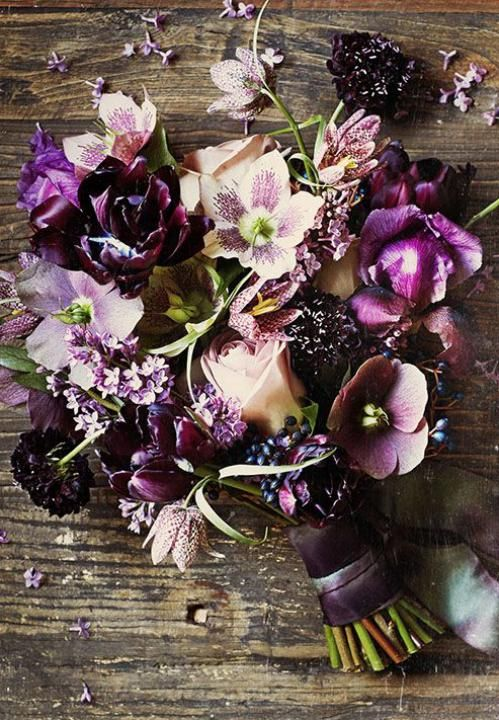 Pretty florals are turned mysterious in shades of plum and mulberry.